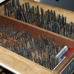 a drawer full of taps