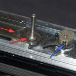 unscrew mirror post and small bolt,red arrows; unscrew cam tension screw, blue arrow; pry up and off the cam and arm
