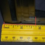 open back flat, measure; ~1.75 inches